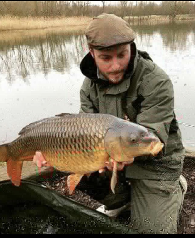 Lee French with one of three carp landed on Becks Lake.